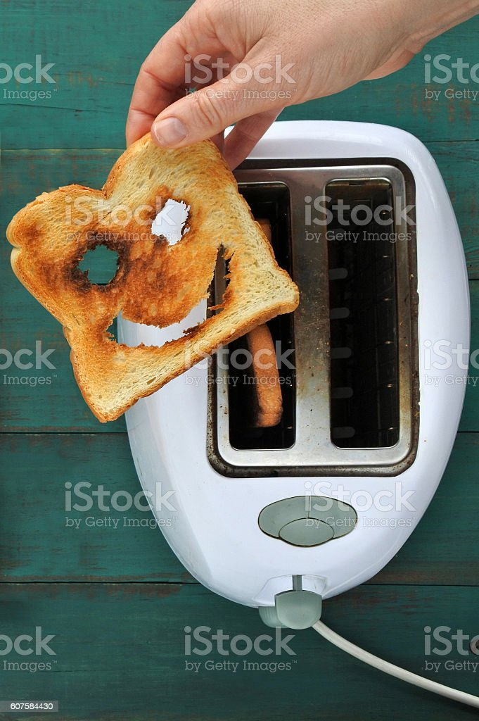 Flat lay view of hand holds slice of toast bread stock photo