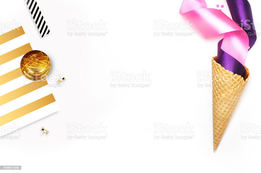 Flat lay, white background. Party photo, ice scream cone and colored ribbons. White background mockup stock photo