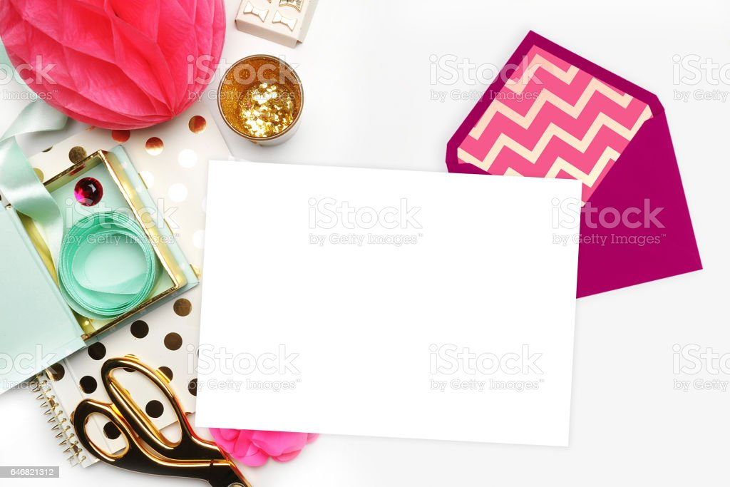 Flat lay. White background. Woman desktop, template card, Mock up for your photo or text Place your work. Gold Polka. stock photo