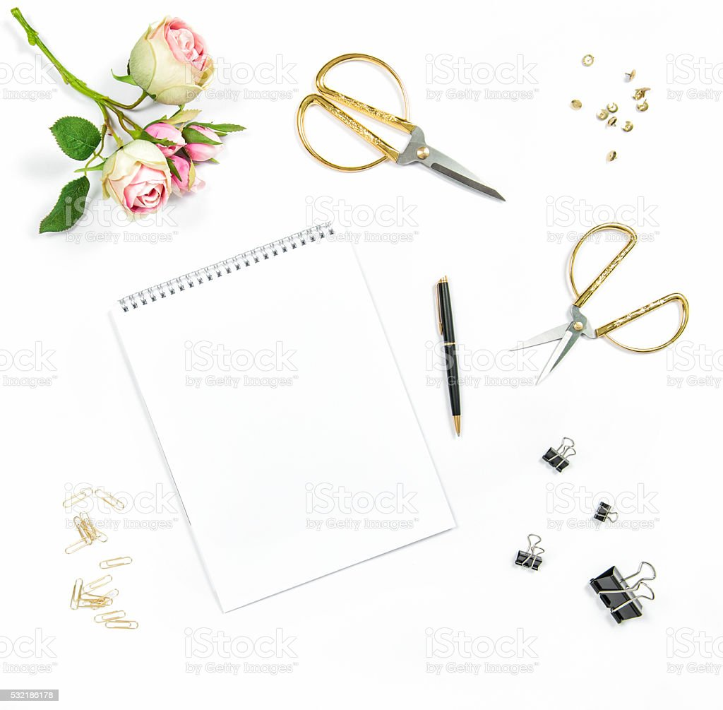 Flat lay with sketchbook, flowers, office tools stock photo