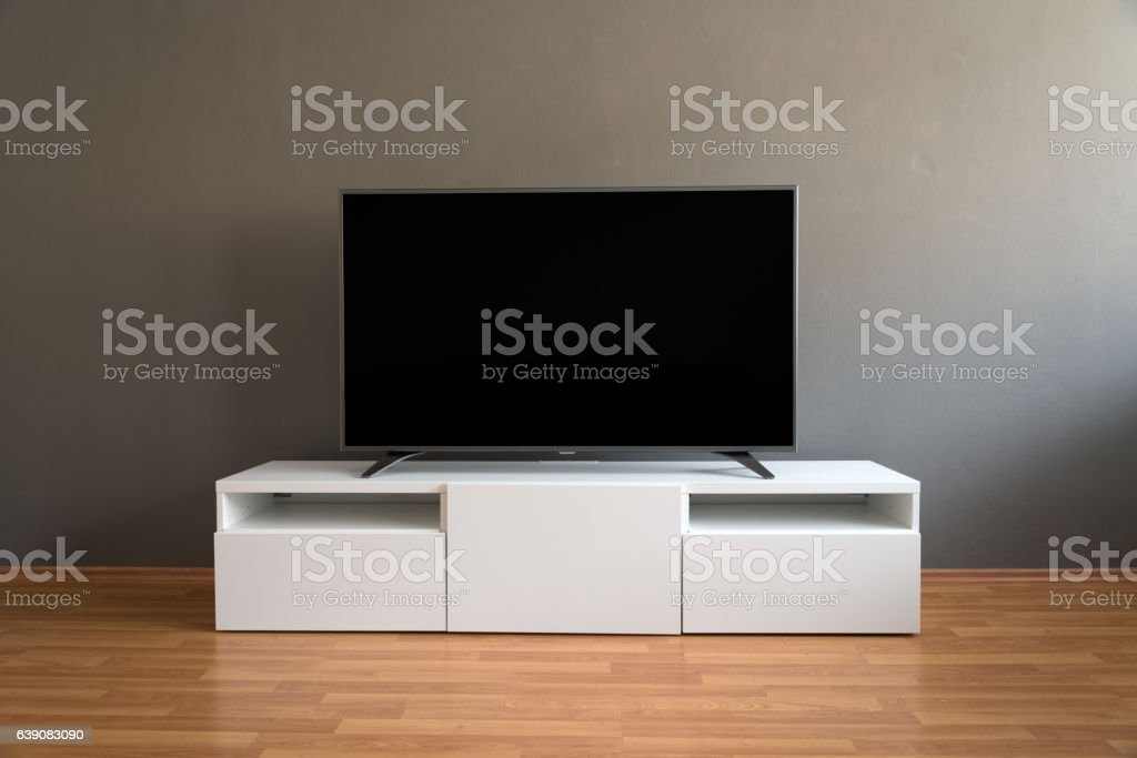 Flat LCD television on white cabinet stock photo