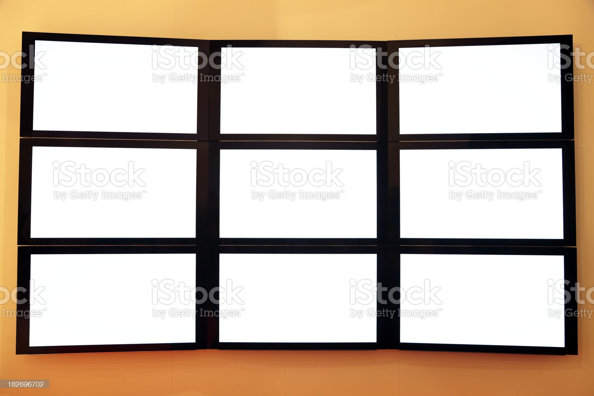 Flat LCD TV screens on a wall royalty-free stock photo
