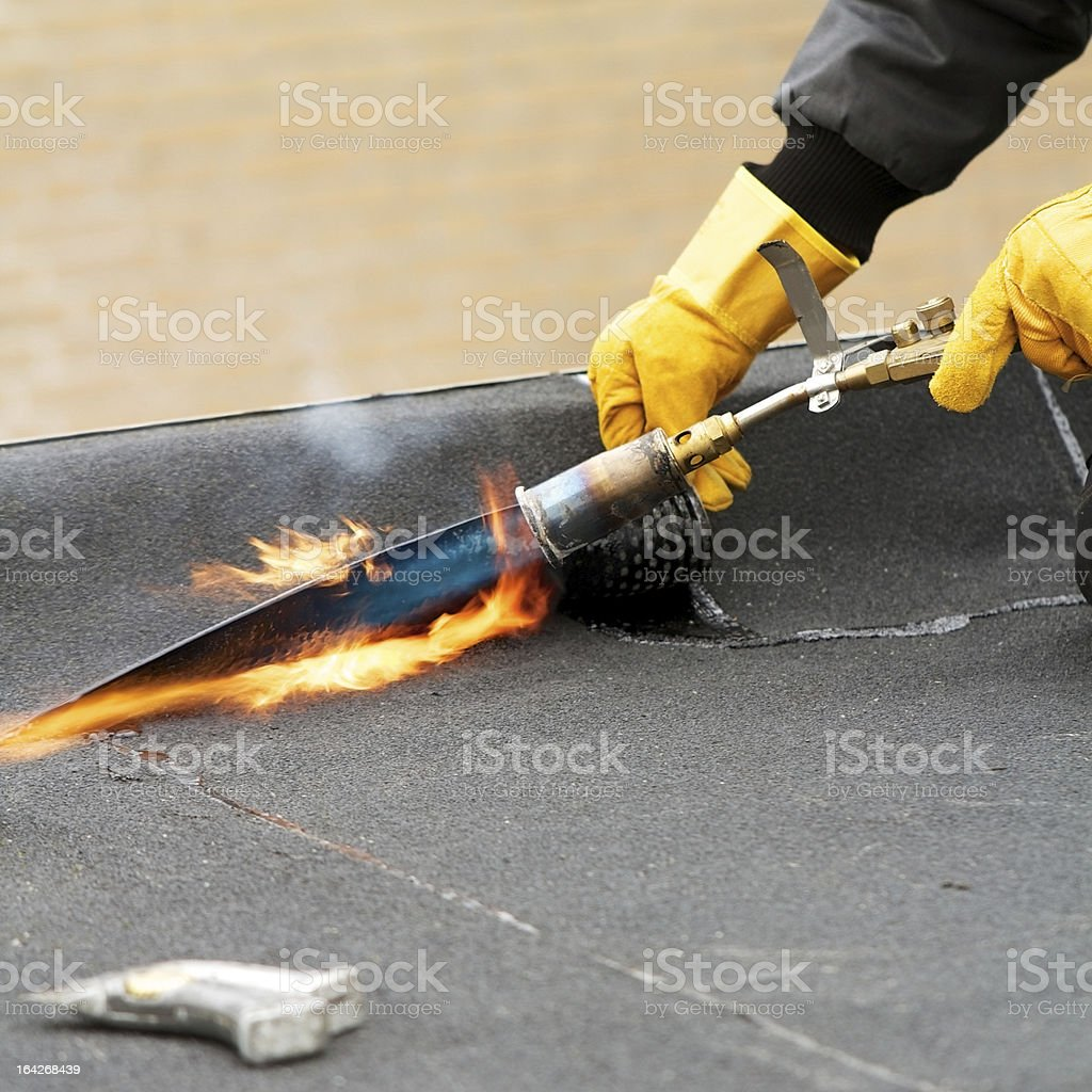 Flat roof covering with roofing felt royalty-free stock photo