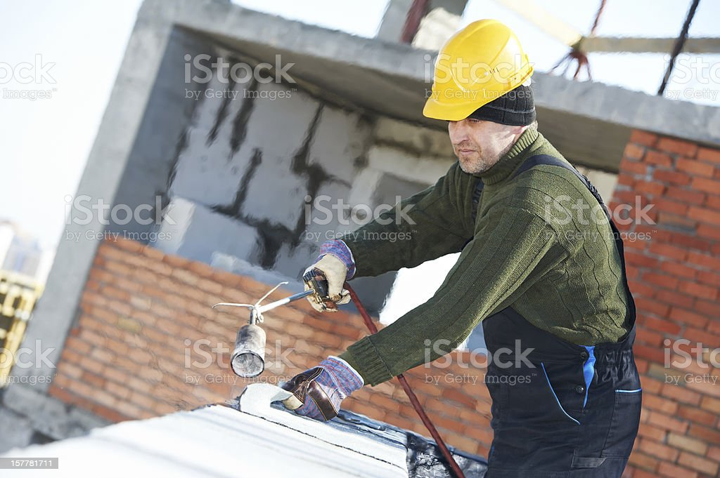 Flat roof covering works with roofing felt royalty-free stock photo
