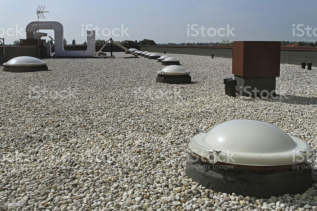 Flat roof with gravel stock photo