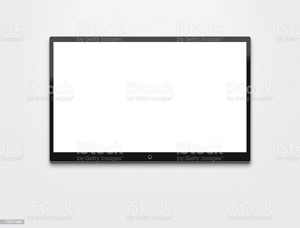 Flat screen TV at the wall royalty-free stock photo