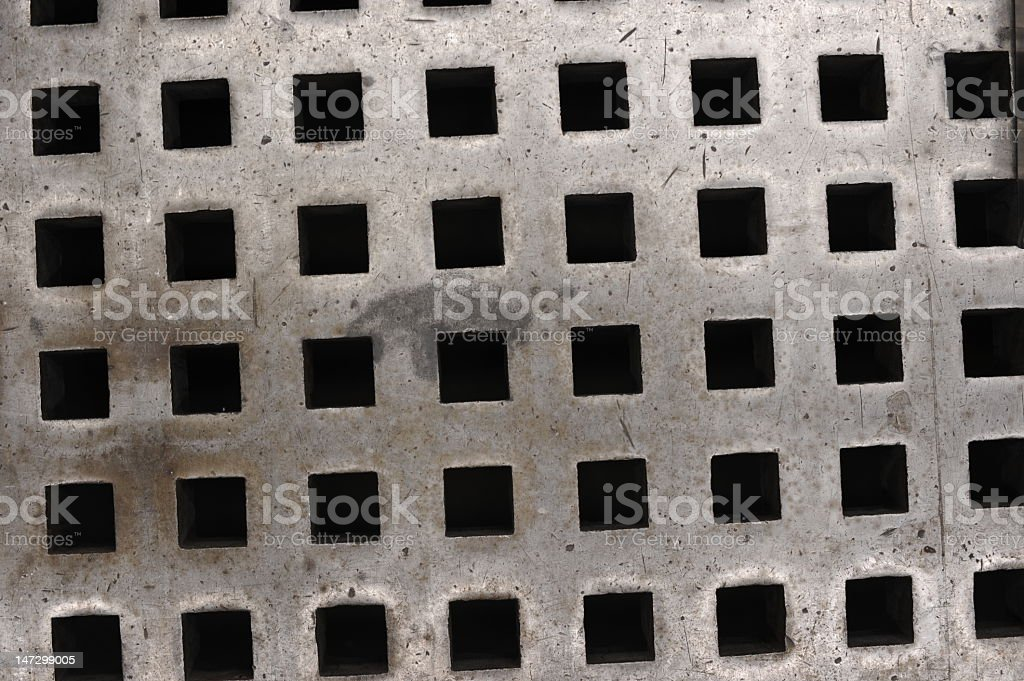 Flat surface with square holes stock photo