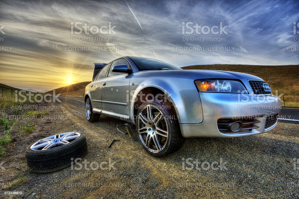 HDRI - Flat Tire At Sunset in the Country stock photo