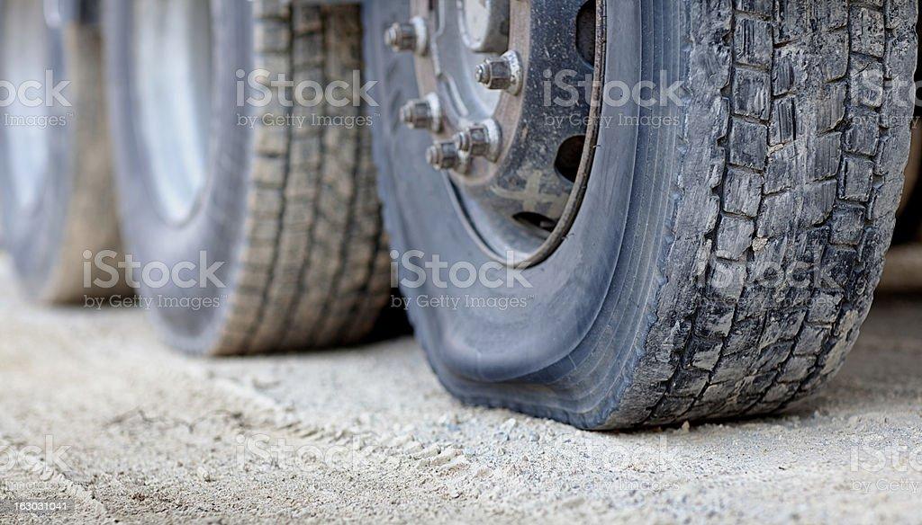 Flat Tire on a Semi Trailer stock photo
