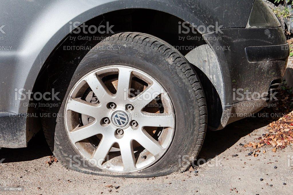 Vilnius, Lithuania - October 25, 2015: Flat tire on VW stock photo