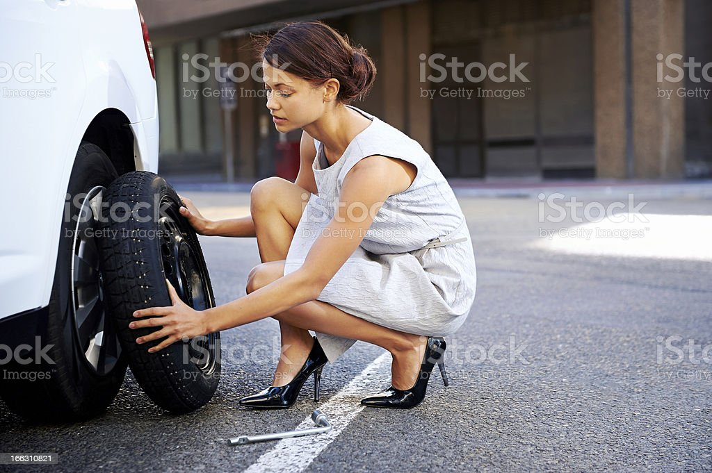 flat tire woman stock photo