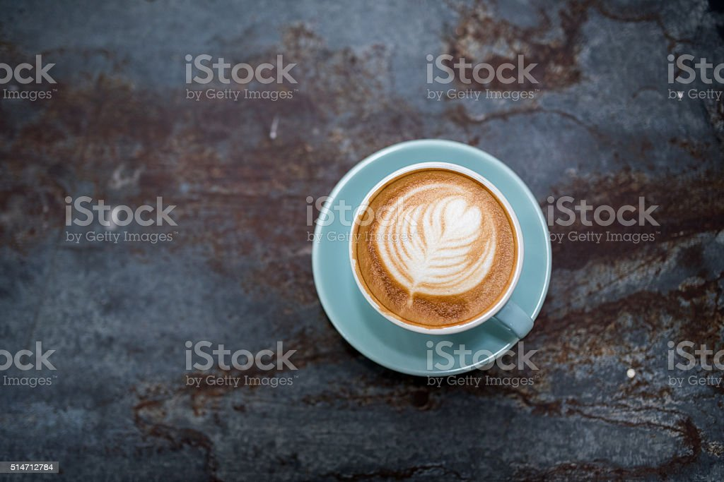 Flat White coffee on Rusty Metal Background stock photo