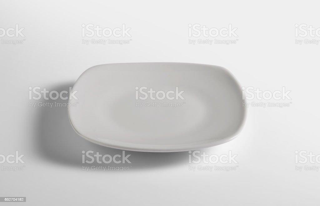 Flat white empty square plate stock photo