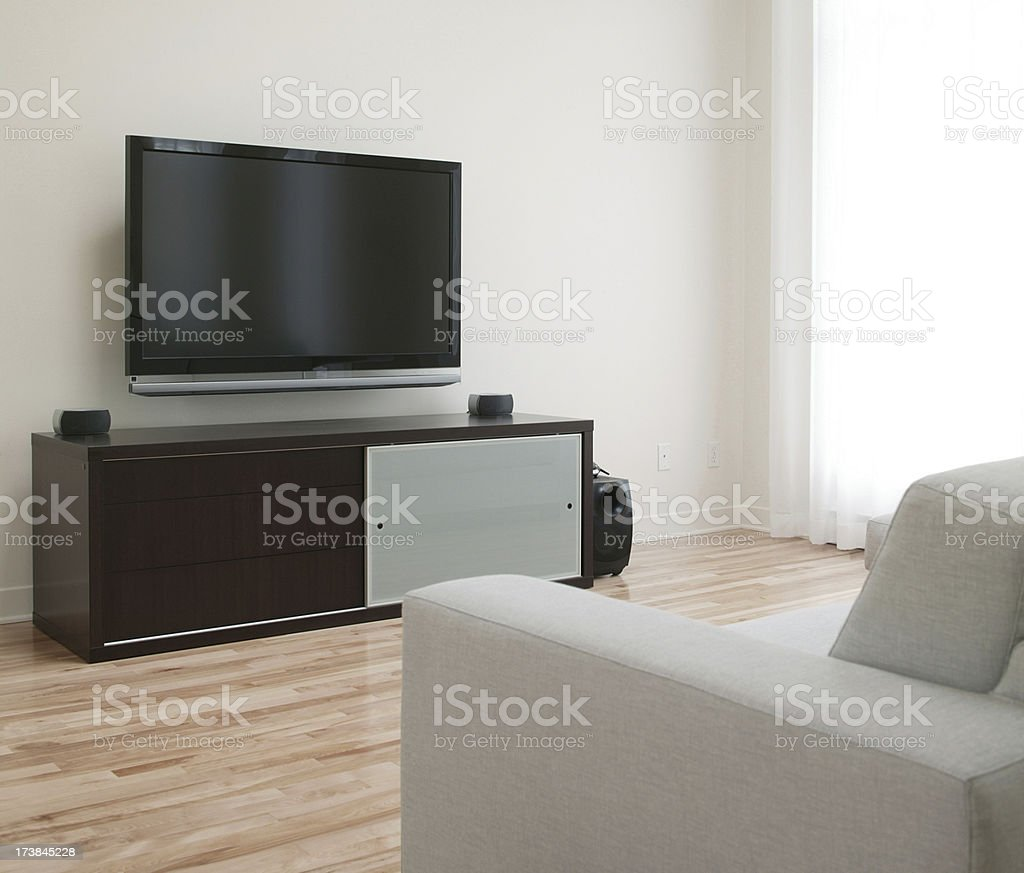 flat wide screen tv in home living room stock photo