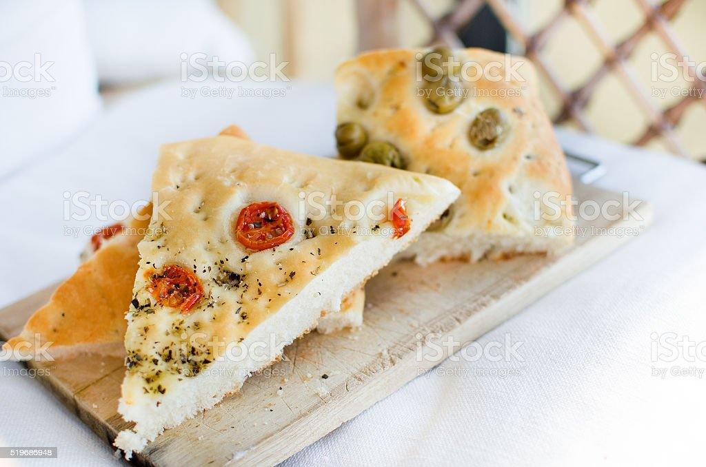 flatbread italy focaccia tomatoes olives flat oven baked Italian stock photo