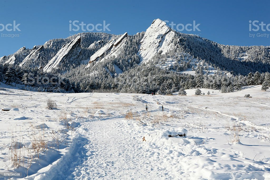 Flatirons mountains with snow, Boulder CO stock photo