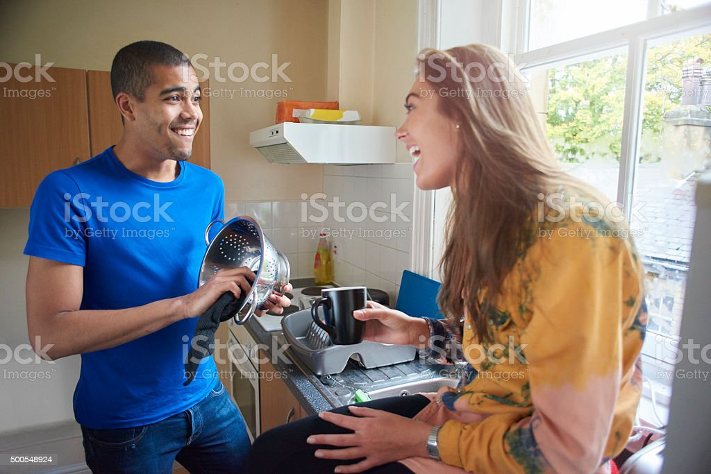 flatmates in their kitchen stock photo