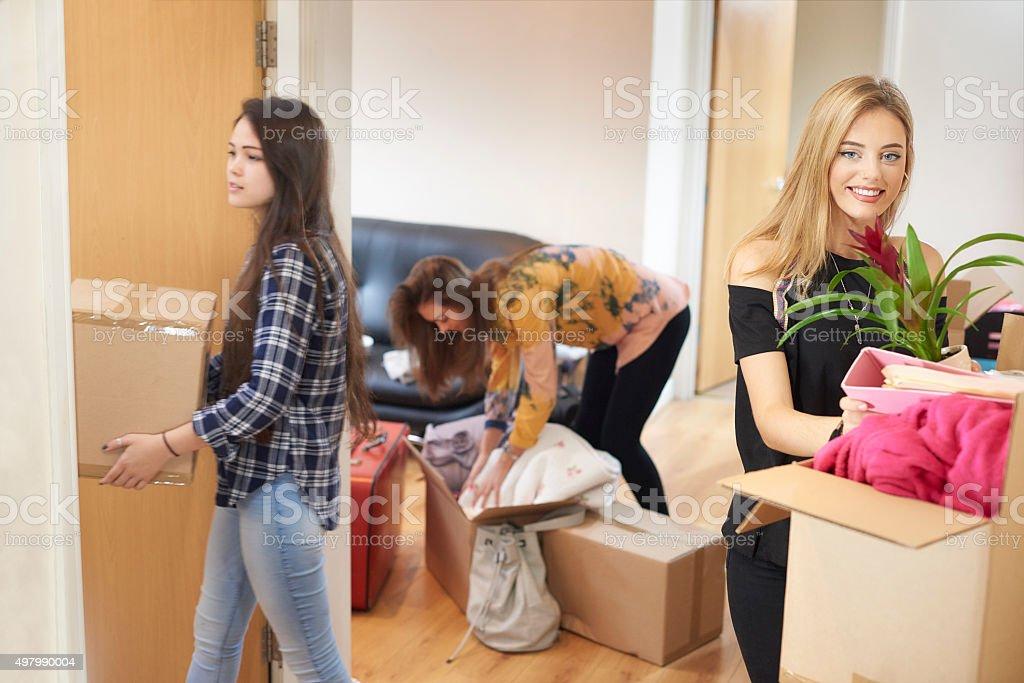 flatmates moving into new flat stock photo