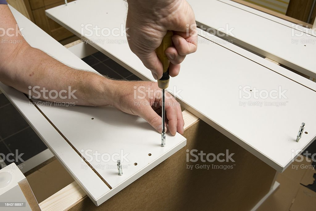 Flat-pack furniture assembly royalty-free stock photo