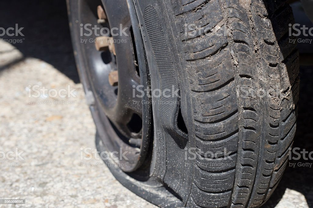 Flatten car tyre close up stock photo