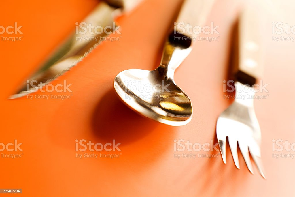 Flatware against orange royalty-free stock photo