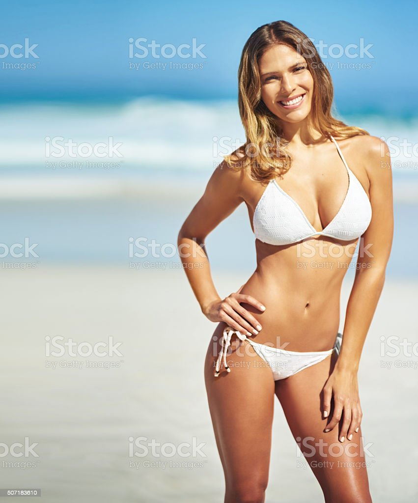 Flaunting her fine summer physique stock photo