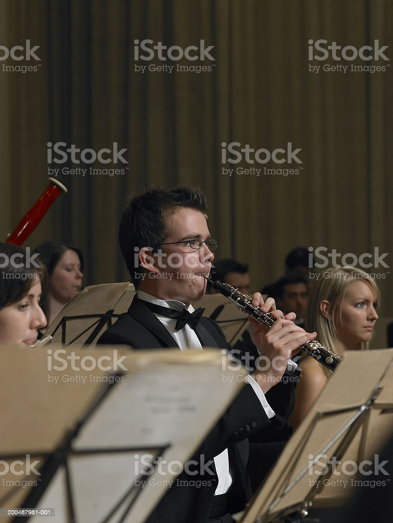 Flautist and oboe player performing in orchestra stock photo
