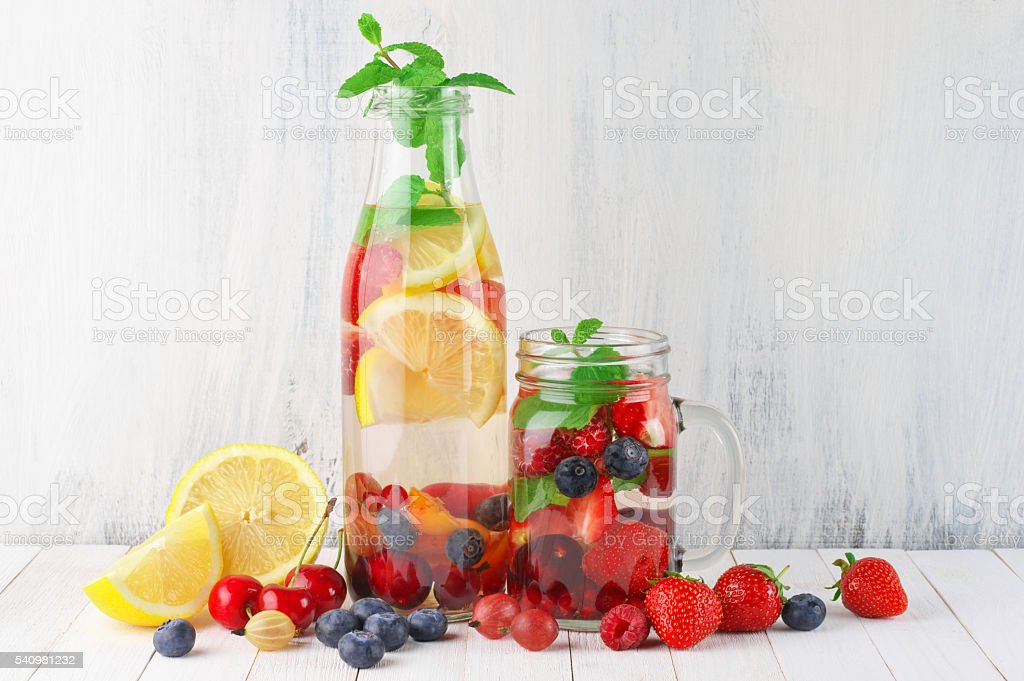 Flavored fruit infused water stock photo