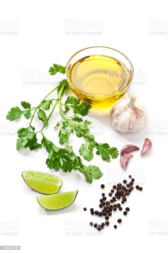 Flavoring ingredients: olive oil, garlic, pepper, lime and cilantro stock photo