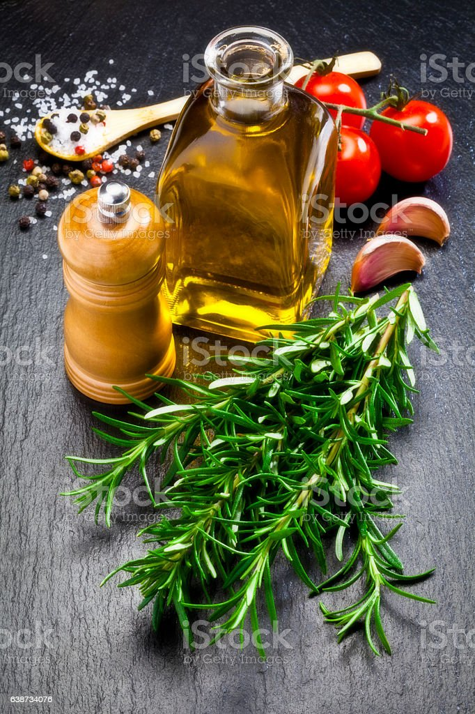 Flavoring: olive oil, garlic, pepper and rosemary stock photo