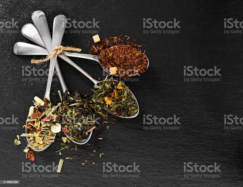 Flavoured and flower tea in metal spoon stock photo
