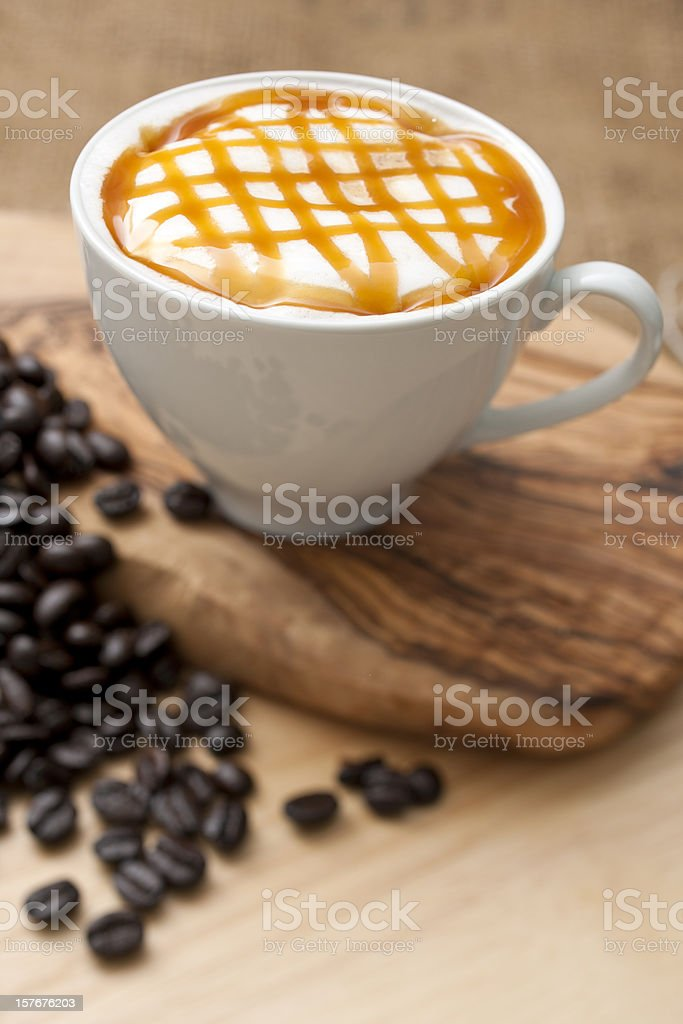 Flavoured Latte topped with a caramel lattice. stock photo