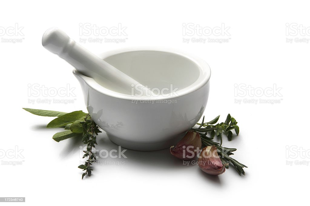 Flavouring: Mortar and Pestle with Herbs royalty-free stock photo