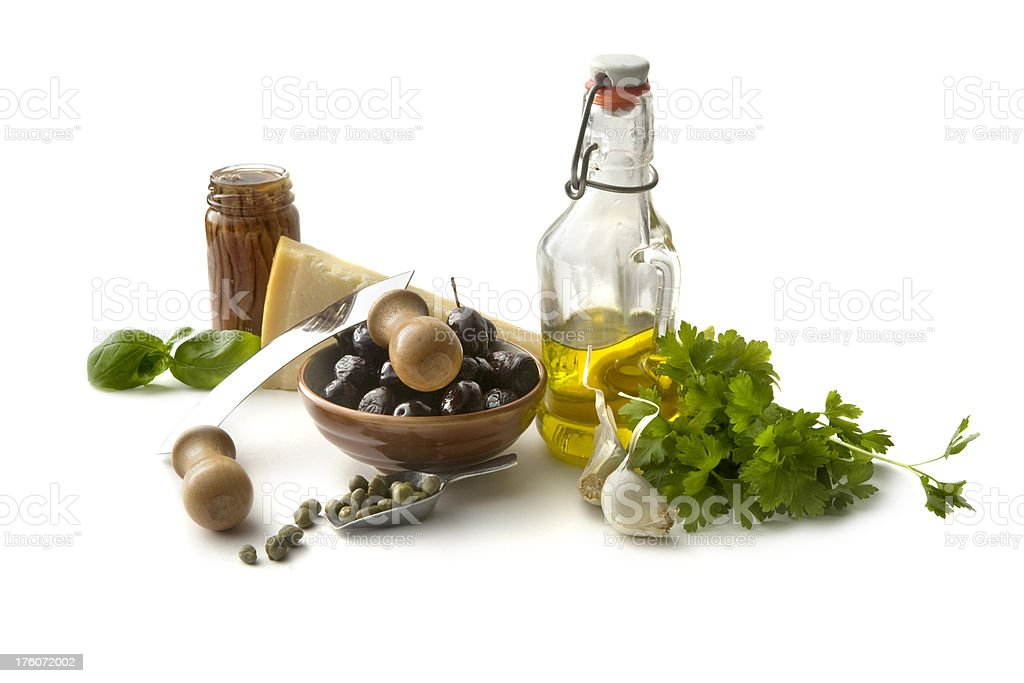Flavouring: Olives, Olive Oil, Parsley, Capers, Garlic, Anchovy and Basil royalty-free stock photo
