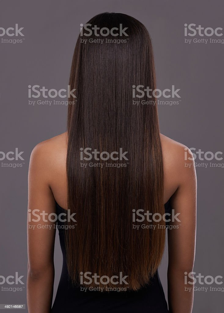 Flawless hair thanks to her trusty flat iron! stock photo