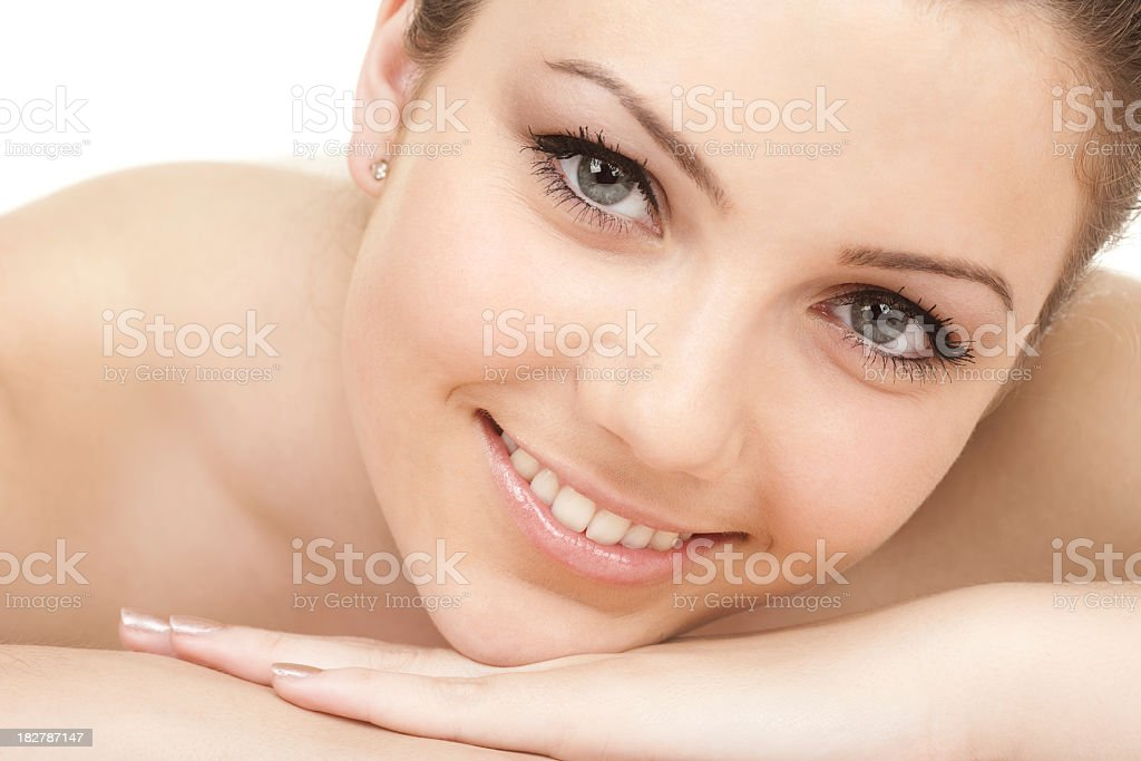 Flawless women rest chin on folded hands royalty-free stock photo