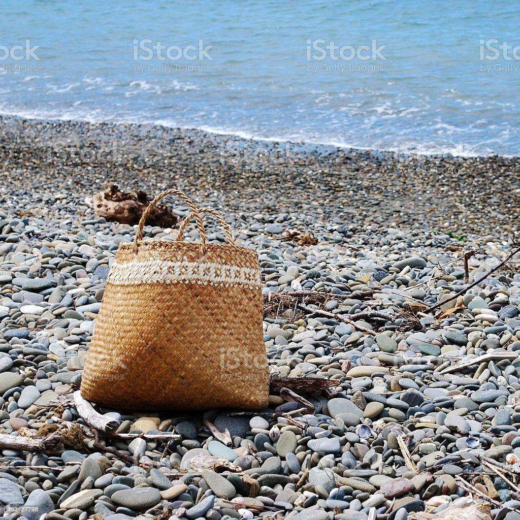Flax Kete on Beach stock photo