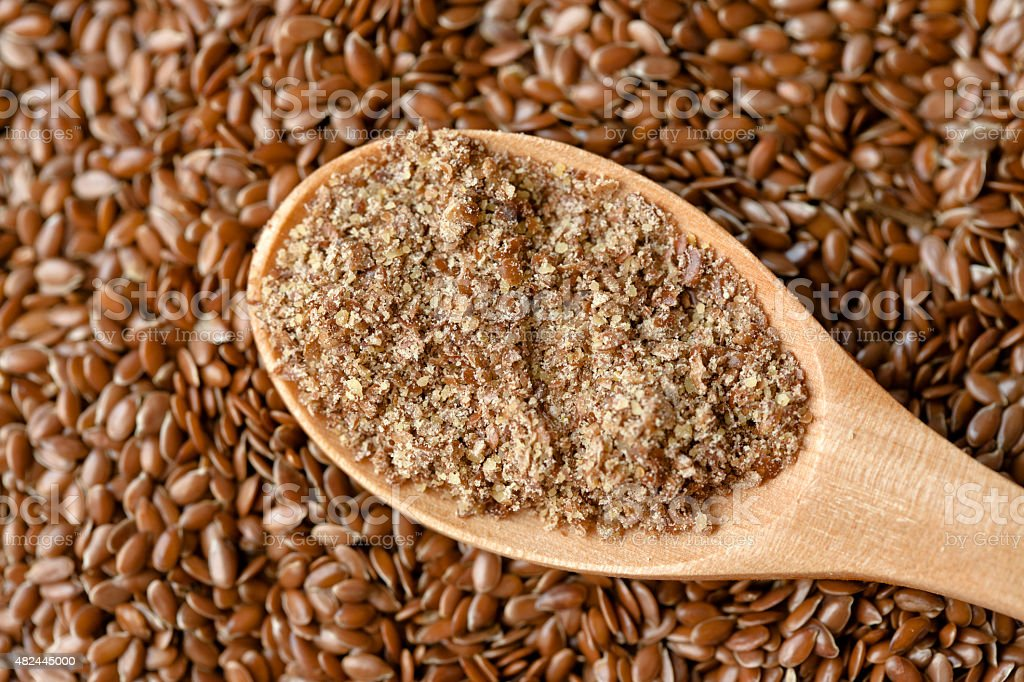 Flax powder and seeds stock photo