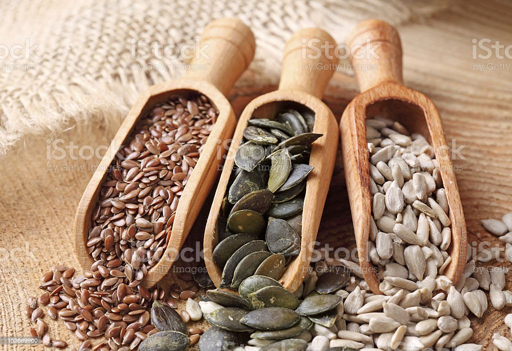Flax, pumpkin and sunflower seeds stock photo