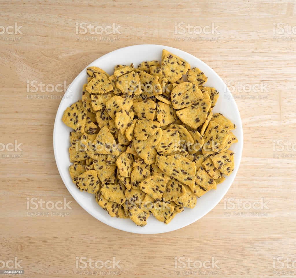 Flax seed corn chips on a plate atop a table stock photo