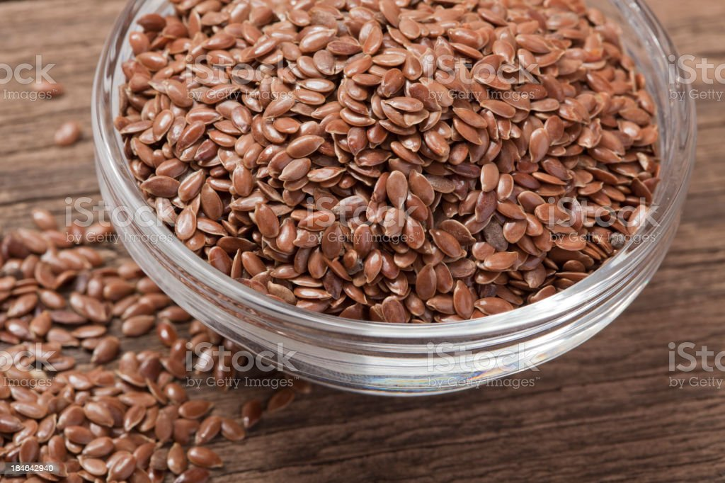 Flax seed in glass bowl - closeup stock photo