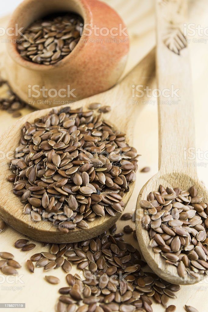 Flax Seed in wooden spoons stock photo