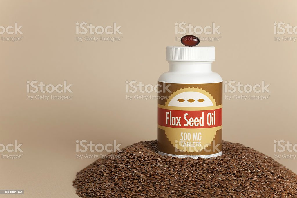 Flax Seed Oil Caplets & Seeds stock photo