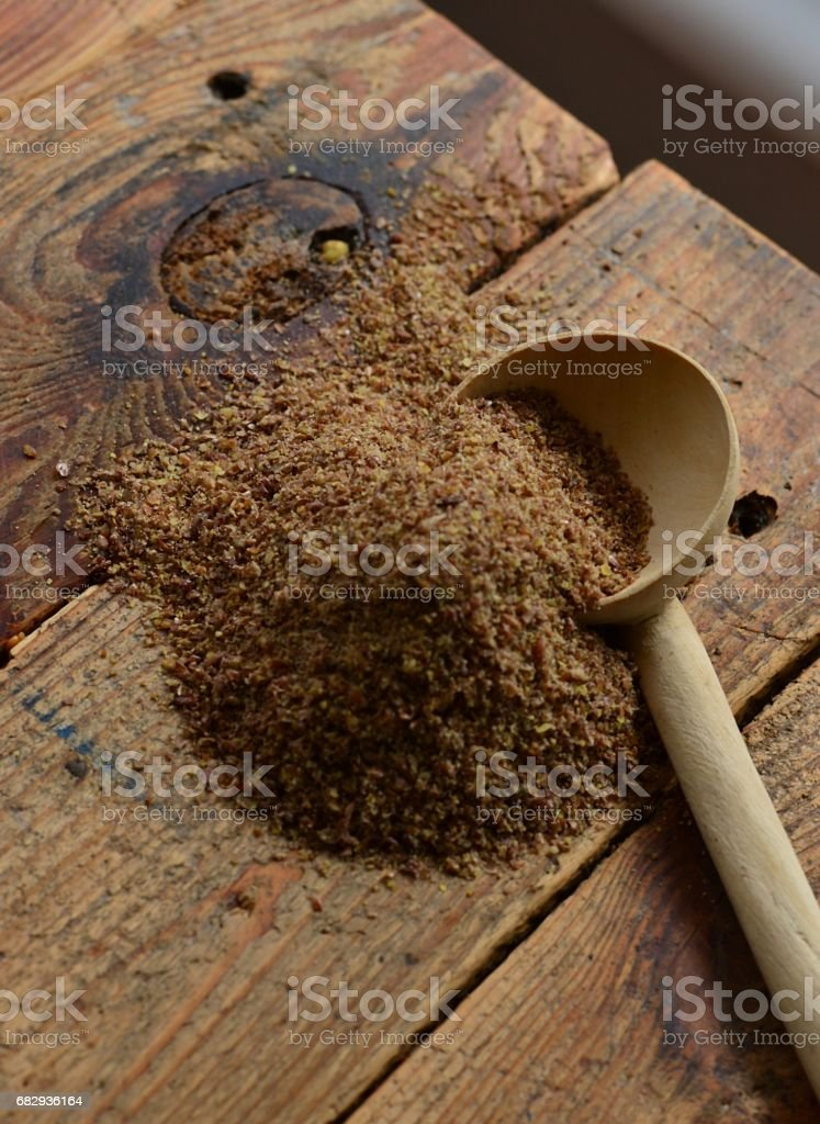 Flax Seed on rustic wooden spoon stock photo