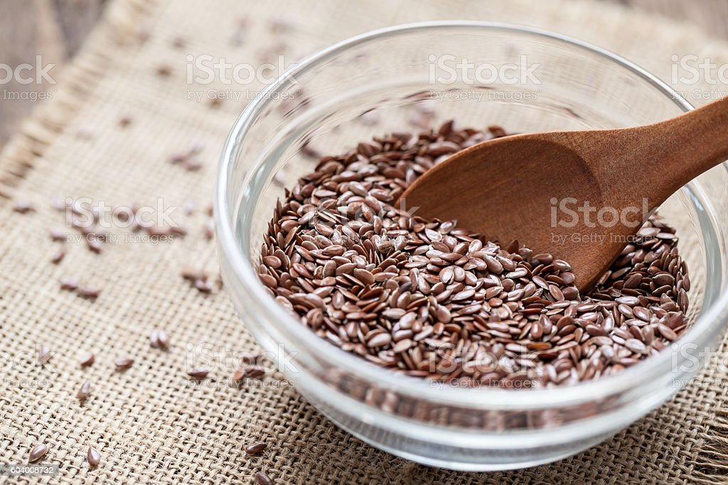 Flax seeds in a bowl stock photo