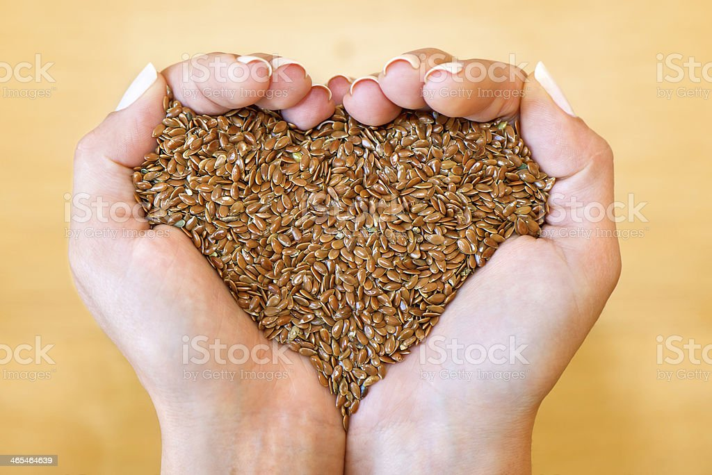 Flax seeds in heart shape stock photo