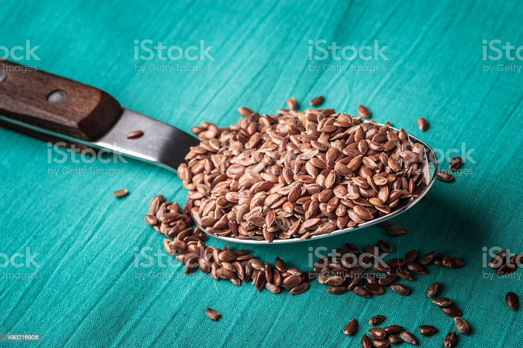Flax seeds linseed on kitchen spoon stock photo