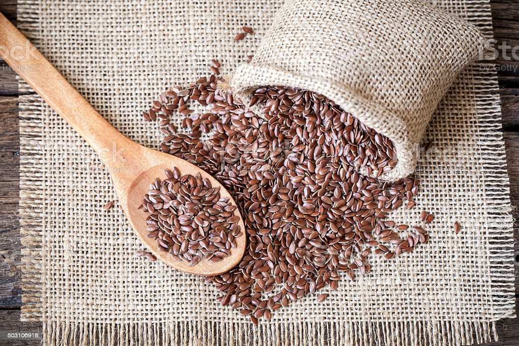 Flax seeds on the sack stock photo