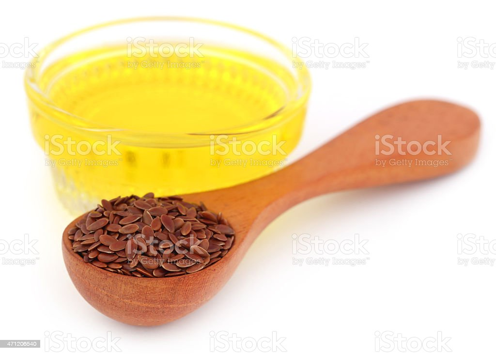 Flax seeds with oil stock photo