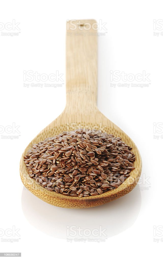 flax-seed in wooden spoon royalty-free stock photo